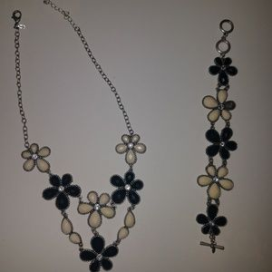 Black and off white flower shaped necklace and bra